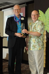 Mayor Knapp accepting the First Citizen award from Rotary president Richard Martens.